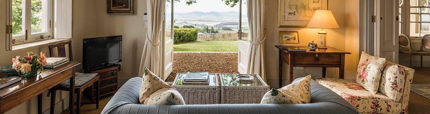 Charming self-catering cottage for two in the Stellenbosch Winelands; glorious views over vineyards towards Table Mountain and the Stellenbosch hills with the magnificent Helderberg mountain being Longfield's protective backdrop